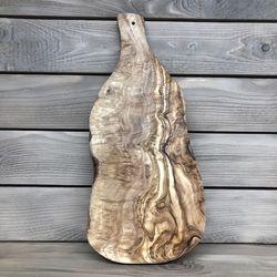 Krájecí prkénko z olivového dřeva s rukojetí, cca 40 x 18 cm
